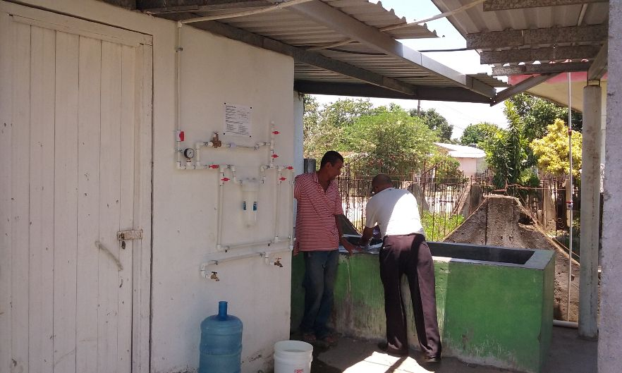 Local Men with New Water Filter